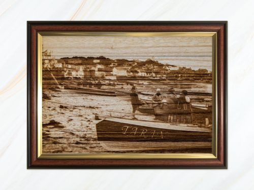 Wooden pyrograph of Taran on Town Beach