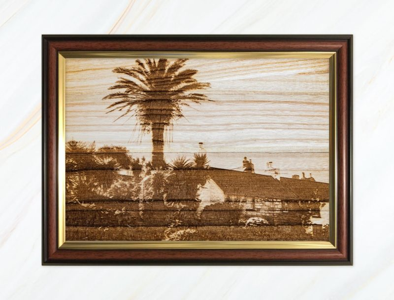 Wooden pyrograph of palm tree on St Mary's