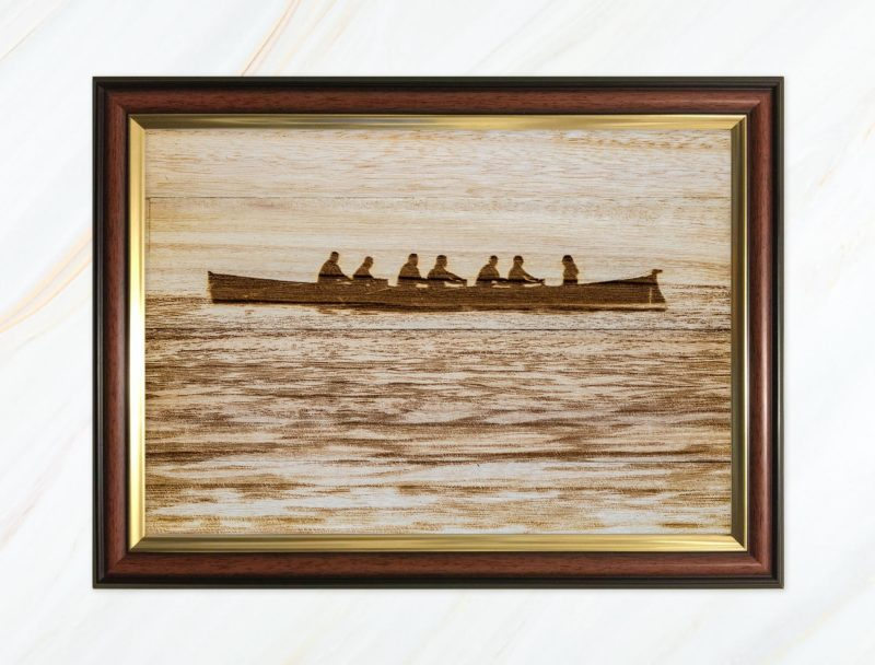 Wooden pyrograph of gig in calm waters