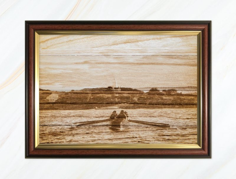 Wooden pyrograph of Gig rowing towards St Agnes