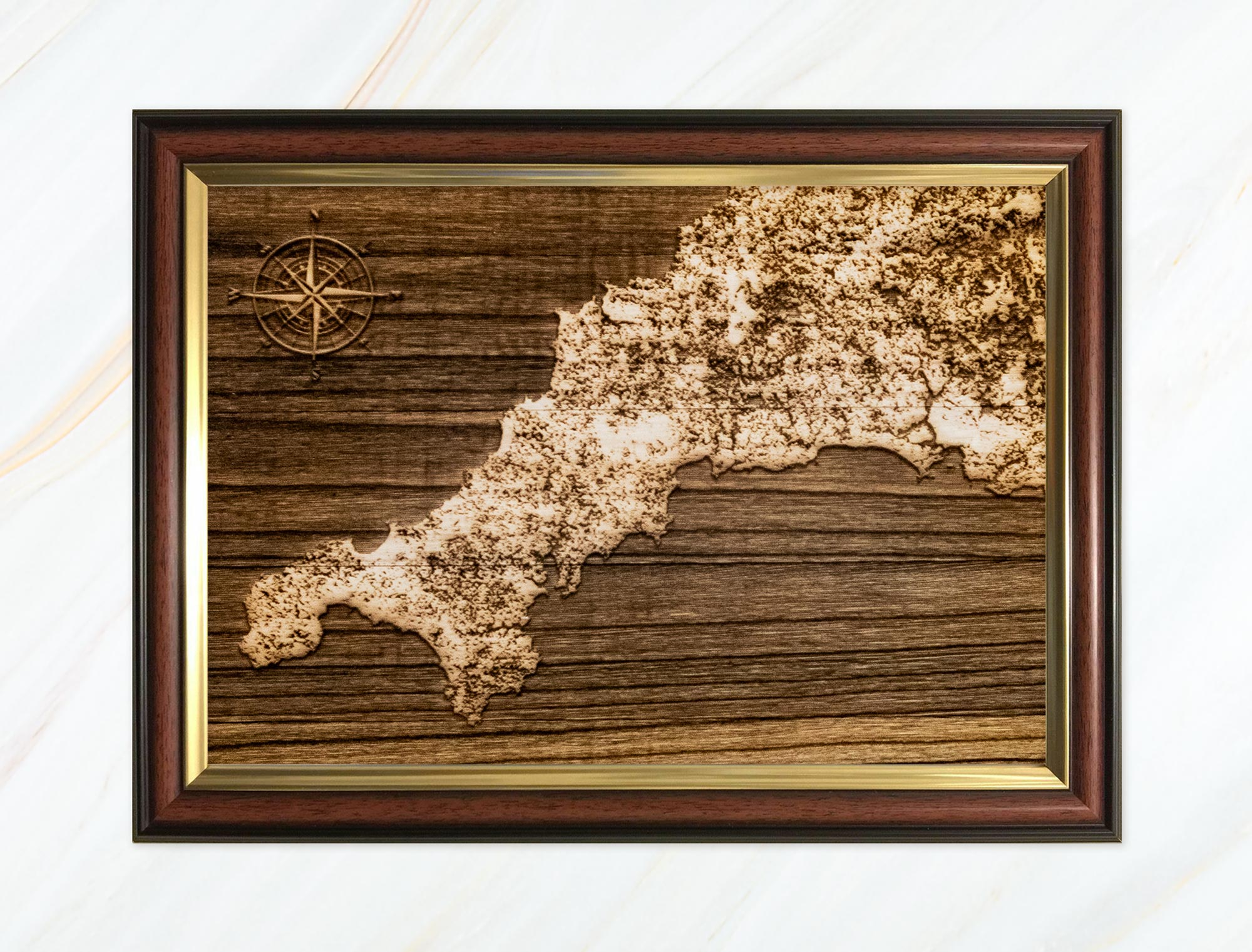 Wooden pyrograph of map of Cornwall dark