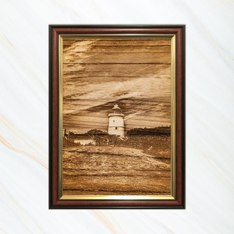 Wooden pyrograph of St Agnes lighthouse