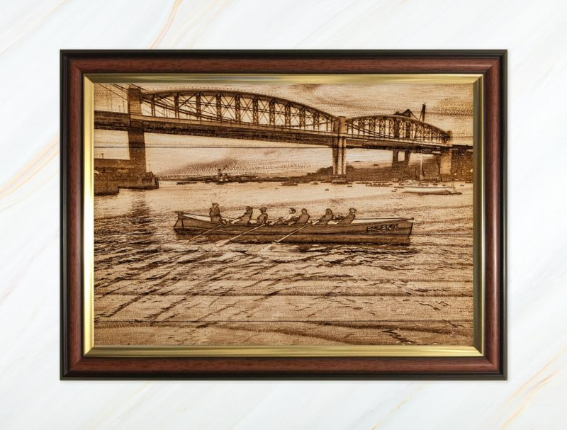 Wooden pyrograph of Tamar Bridge with gigs